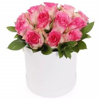 Pink roses in a cylinder flower box