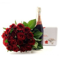 Roses 50 cm, sparkling drink and Raffaello sweets